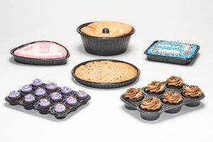 selection of bakery items in different containers and trays