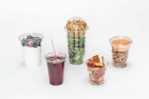plastic cups with lids, containing food and drink
