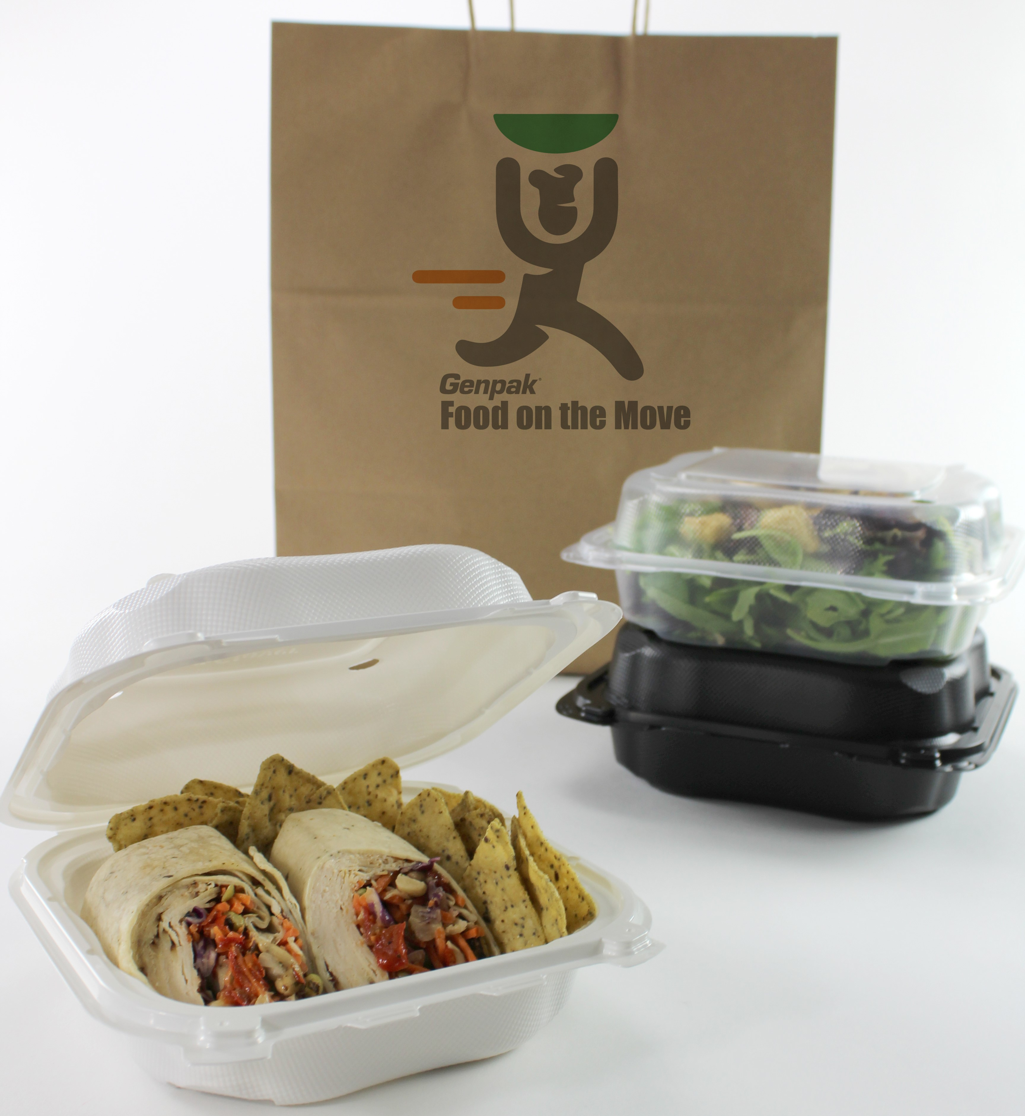 hinged containers with food in them next to delivery/takeout bag